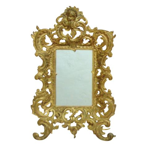 antique brass framed mirror at large antique brass cherub mirror picture frame rococo style putti sold on ruby
