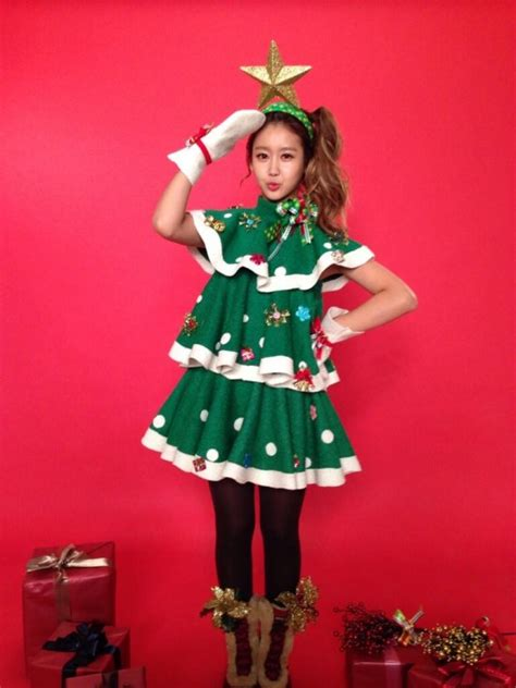 crayon pop dress up as christmas trees for their upcoming