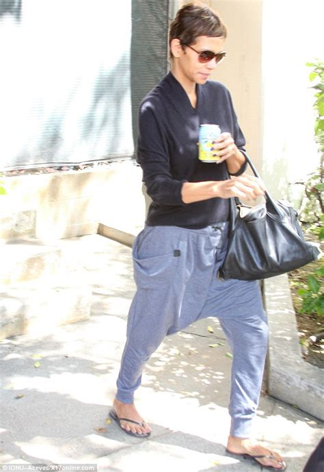 Halle Berry Gets On Knees For A by Halle Berry Drowns Out Figure With A Pair Of