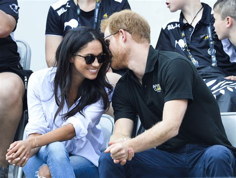 harry meghan is prince harry holding meghan markle s a sign of