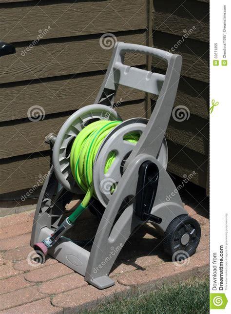 plastic garden hose reel cart  wheels stock image