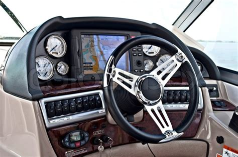 speed boat dashboard instrument panel and steering wheel of a motor boat