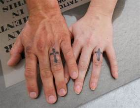 cross tattoo meaning on finger ring finger cross tattoos tattoos expression of art