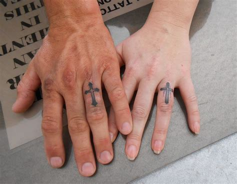cross on finger tattoo ring finger cross tattoos tattoos expression of