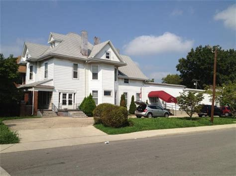 former gray funeral home for sale at 2428 e 10th