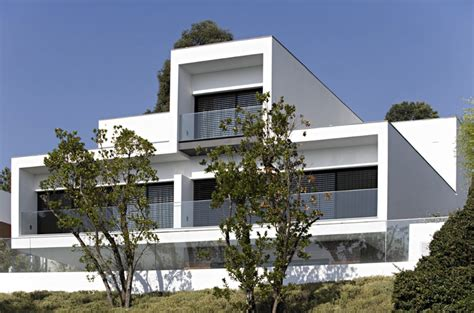 white concrete three storey house cs house by pitagoras