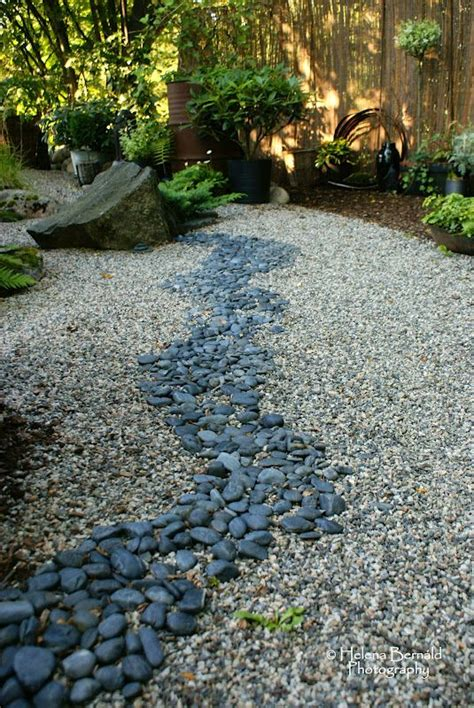 Backyard Creek Bed by The Line Of Rocks Creates A Serene Gravel Garden