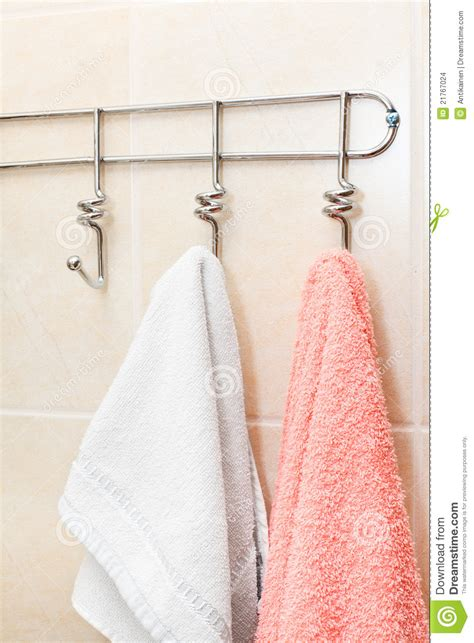 terry towels hanging   hooks stock photo image