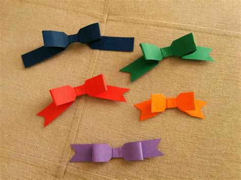 How To Make A Ribbon Origami - lacinhos de origami origami ribbon origami