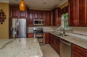 Granite Countertops With Cherry Cabinets Golden Ivory Granite With Cherry Cabinets Traditional