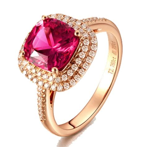 2 carat cushion cut ruby and halo engagement ring