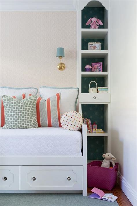 daybed with drawers between floor to ceiling shelves