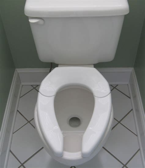 Pictures Of Toilet Bowls Adjust For Comfort Unveils Revolutionary New Toilet Seat