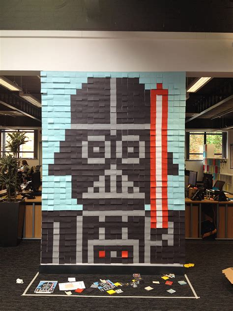 creative employees decorate  office walls