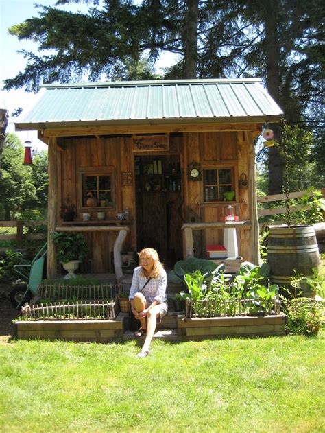 becky sitting  front   cute garden shed
