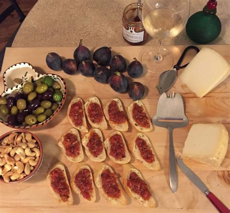 italian appetizers for dinner bruschetta olives fresh figs cashews and 2 kinds of