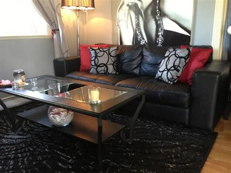 leather couches like hubby loves and accent chairs like i i like the red accent pillows on the leather couch black