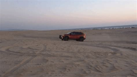 jeep beach sunset storming the beach with the 2016 jeep cherokee trailhawk