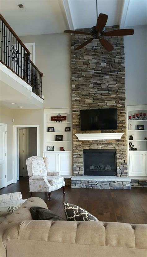 two story fireplace great room with two story stone fireplace and catwalk
