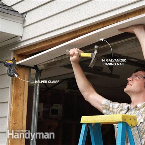 How To Install Overhead Garage Door Fixing Garage Doors The Family Handyman