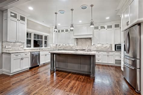 White Kitchens With Islands Awesome Varnished Wood Flooring In White Kitchen Themed