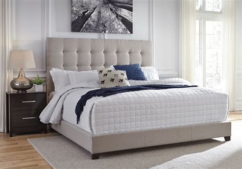 dolante beige king upholstered bed
