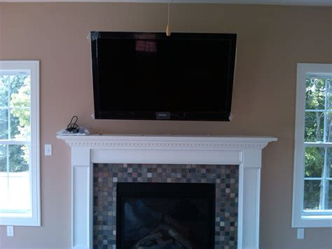 Mounting Tv Gas Fireplace by Tv Mounted Fireplace 2015 Home Design Ideas