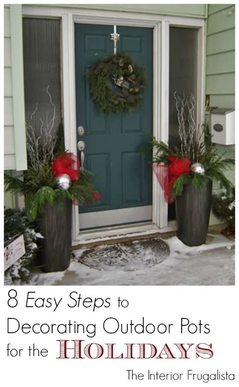 christmas decorating huge stone urns in front of entrance how to fill outdoor planters for the holidays the interior frugalista