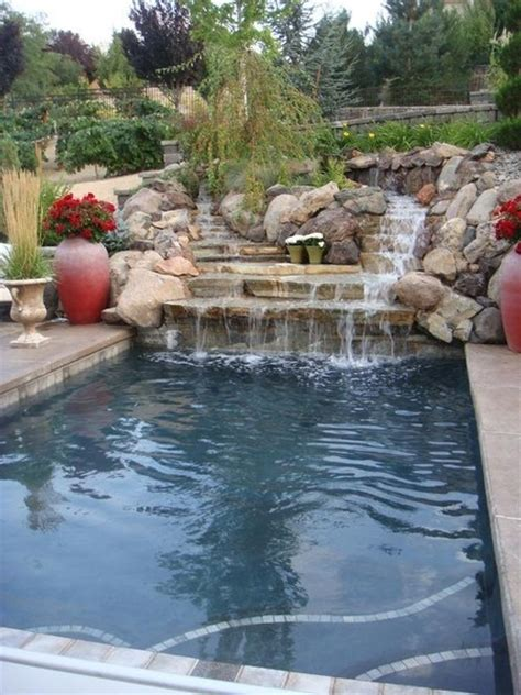 backyard pools with waterfalls waterfall on a rectangle pool too much rock for me but