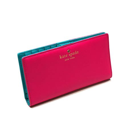 the pink clutch a small space with a big statement kate spade stacy brightspot avenue peony pink small wallet