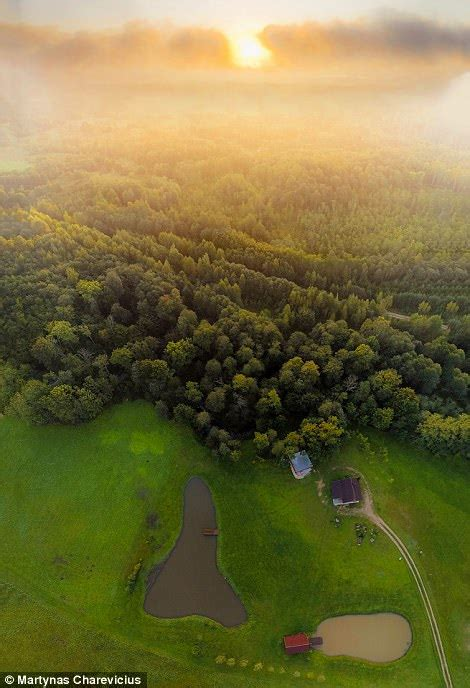 two houses side by side stunning drone images capture the true beauty of lithuania daily mail online