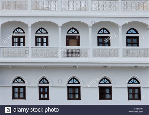 white house windows old omani white house with typical wooden doors and windows in stock photo royalty