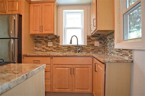 kitchen cabinets and backsplash kitchen remodel with natural maple cabinets granite