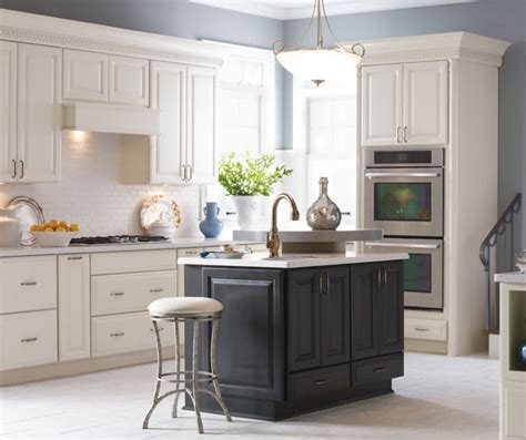 Off white sullivan kitchen cabinets with dark grey island