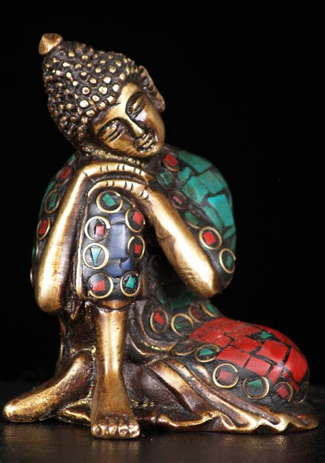 resting buddha statue  colored stones  bs