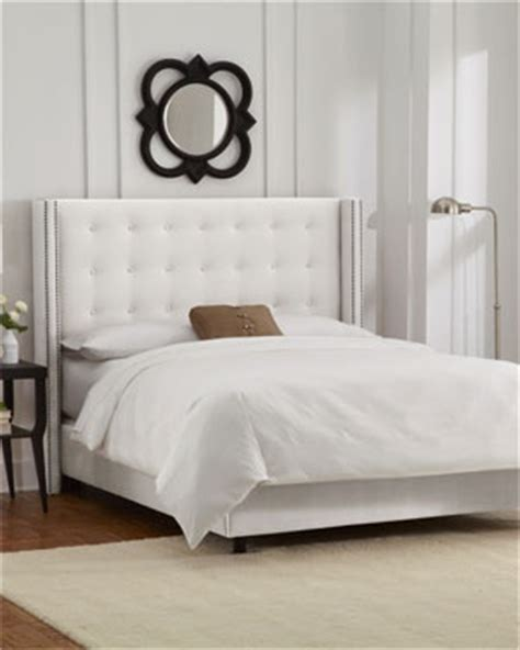 love  white nail studded headboard wingback bed