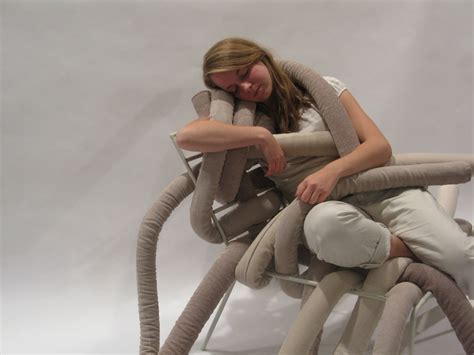 embraced if unique but comfortable chair with pillow
