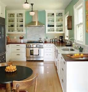 farmhouse kitchen backsplash wood countertops white cupboards white subway tile backsplash blue walls kitchens