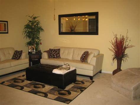 yellow sofa  tan walls cream leather sofa