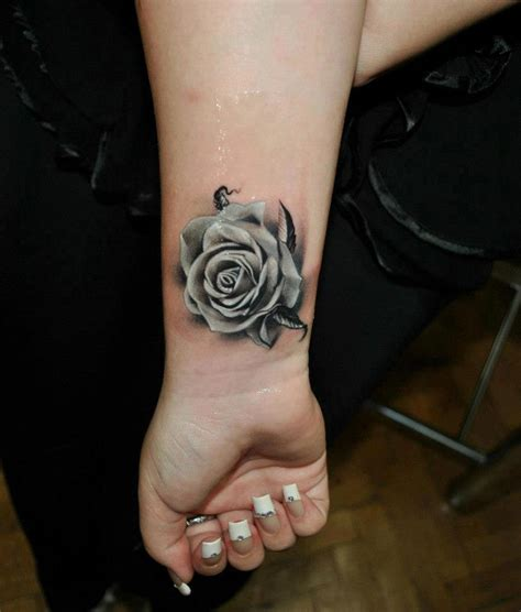 rose on wrist tattoo black n white tattoos
