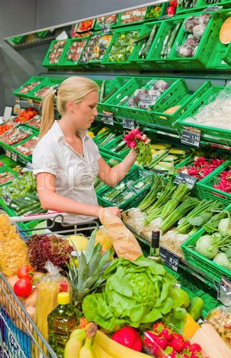 What Is The Shelf Of Vegetable by Shopping For Fruit And Vegetables In A Supermarket Shelf Freshness Stock Photo Colourbox