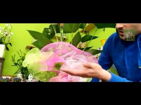 come confezionare un mazzo di fiori lezione 6 confezionare una pianta con rete confezioni