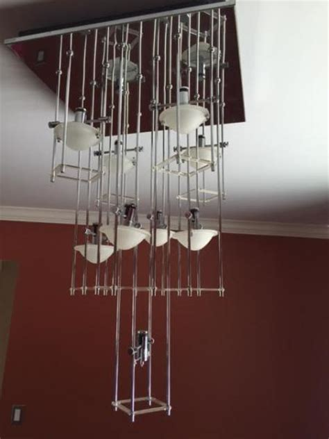 How To Remove A Chandelier From Ceiling by Remove A Flush Mounted Track Light Style Chandelier