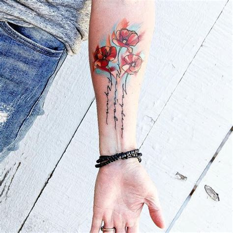 tattoo name board poppy tattoo with my kids names in the stems first