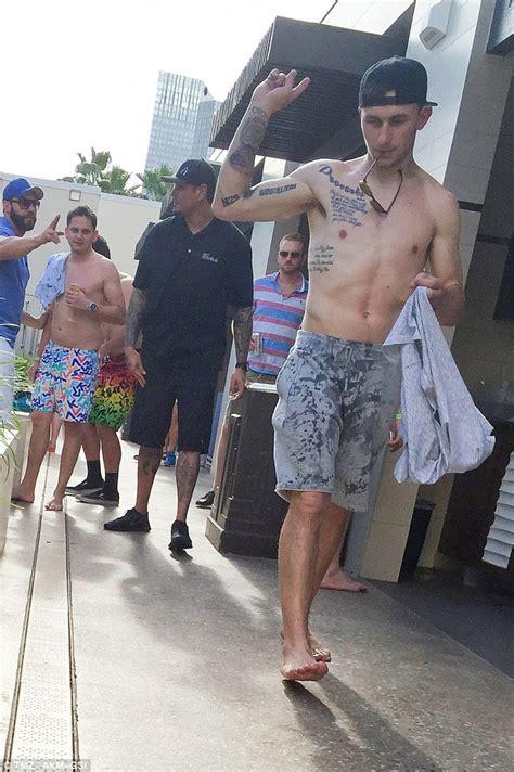 johnny manziel wrist tattoo johnny manziel flaunts skeletal and a few new tattoos