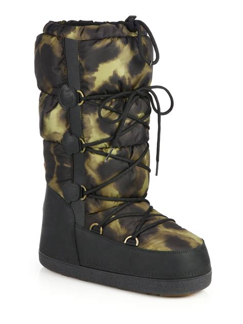 moncler boots lyst moncler leopard print quilted moon boots in black