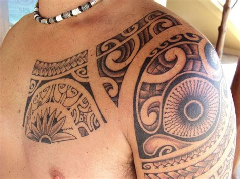 tattoo on chest amp shoulder for men of polynesians tiki s