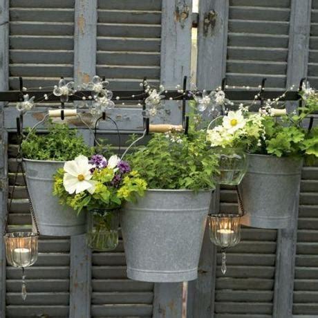 sti per candele l arte riciclo arredare un giardino in stile shabby