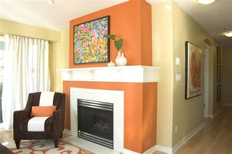 burnt orange wall paint living room contemporary with accent wall baseboards curtains