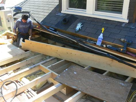 attaching lights to roof line framing a flat roof with slight pitch in preparation for